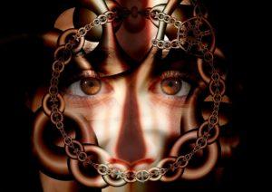 psique humana presa, imagem de correntes envolta de um rosto